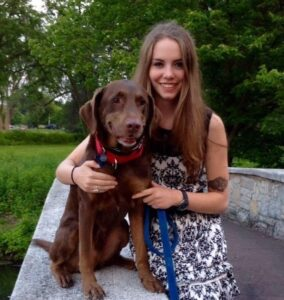 Jenna is pictured with a Chocolate Lab cross, Gus.